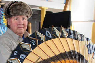 Peter enjoys the challenge of creating art on the ribs and fabric of parasols. See a video about Peter below.