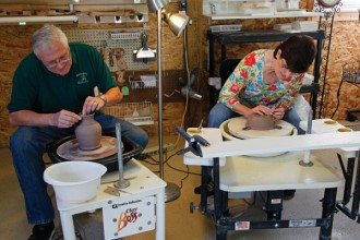 Cub and Pam Storms at work on the potter's wheel.