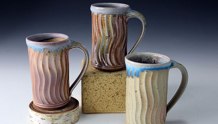 The varied and unpredictable color on each of these three mugs comes from the wood firing process.  There is a new wood fire kiln at the Folk Art Guild in Middlesex that the Guild potters are using to produce unique effects on their ware. Tours of the workshops and studios at the Open House and Apple Festival, October 10 and 11, are possible, as well as sampling live music and a delicious lunch.