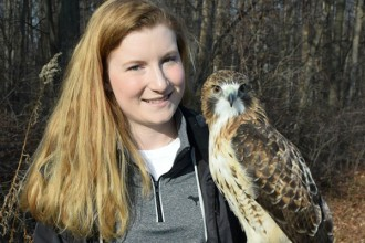Mary Cope with her red-tail hawk, Theron