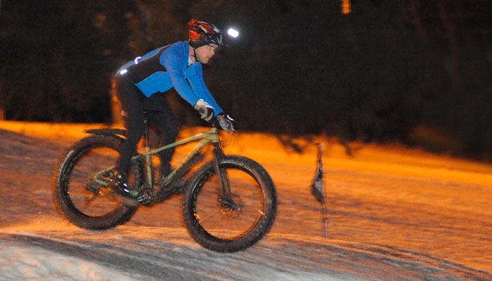 Approximately 25 racers competed in the Feb. 4 criterium at Hunt Hollow. The rider who completes the most laps in one hour is the winner. The unseasonably warm weather softened the snow enough to make pedaling quite difficult for racers.
