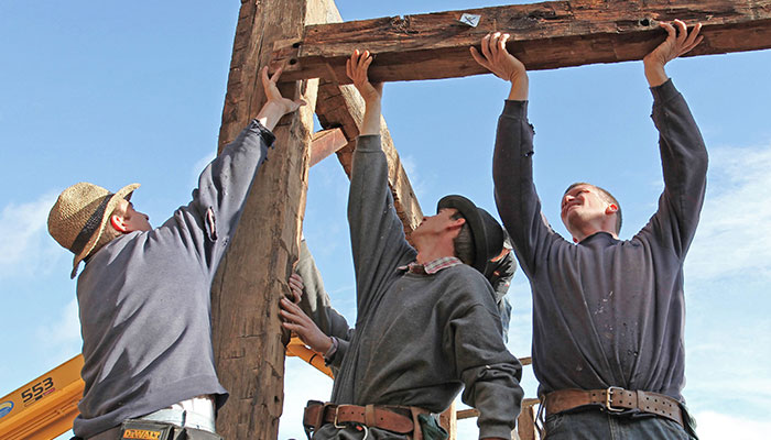 Using the numbered tags on structural members, a team of Mennonite carpenters reassembled the framing and also handled the conversion.