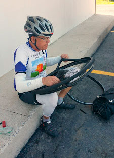 Another flat tire for Roger to fix. Photo courtesy Kathy Behrens
