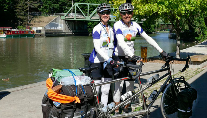 Only 6000 miles to go, Kathy and Roger pose beside their tandem in Pittsford, NY before checking out the local bike shop across the street.