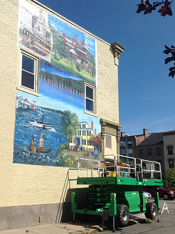 The mural on Coach Street during the installation process.