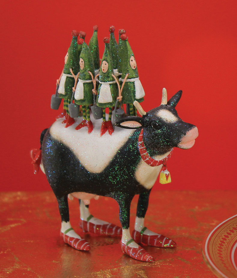 pictured day 8 of the 12 days collection the full sized ornament has 8 christmas tree maids a milking with tiny silver buckets atop their trusty cow