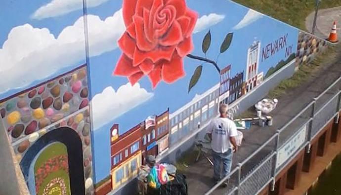 erie canal mural artist paints on site at the savannah art festival